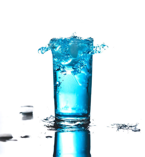 Beverage Blue Liquid Blue Margarita Drinks Drops Freshness Refreshment Beveragephotography Blue Beverage Blue Cocktail Blue Drink Blue Martini Blue Sky Close-up Curacao Drink Isolated Drinking Glass Glass Motion No People Purity Studio Shot