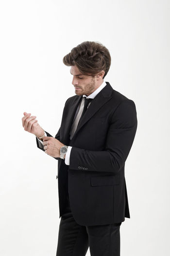Man wearing suit against white background