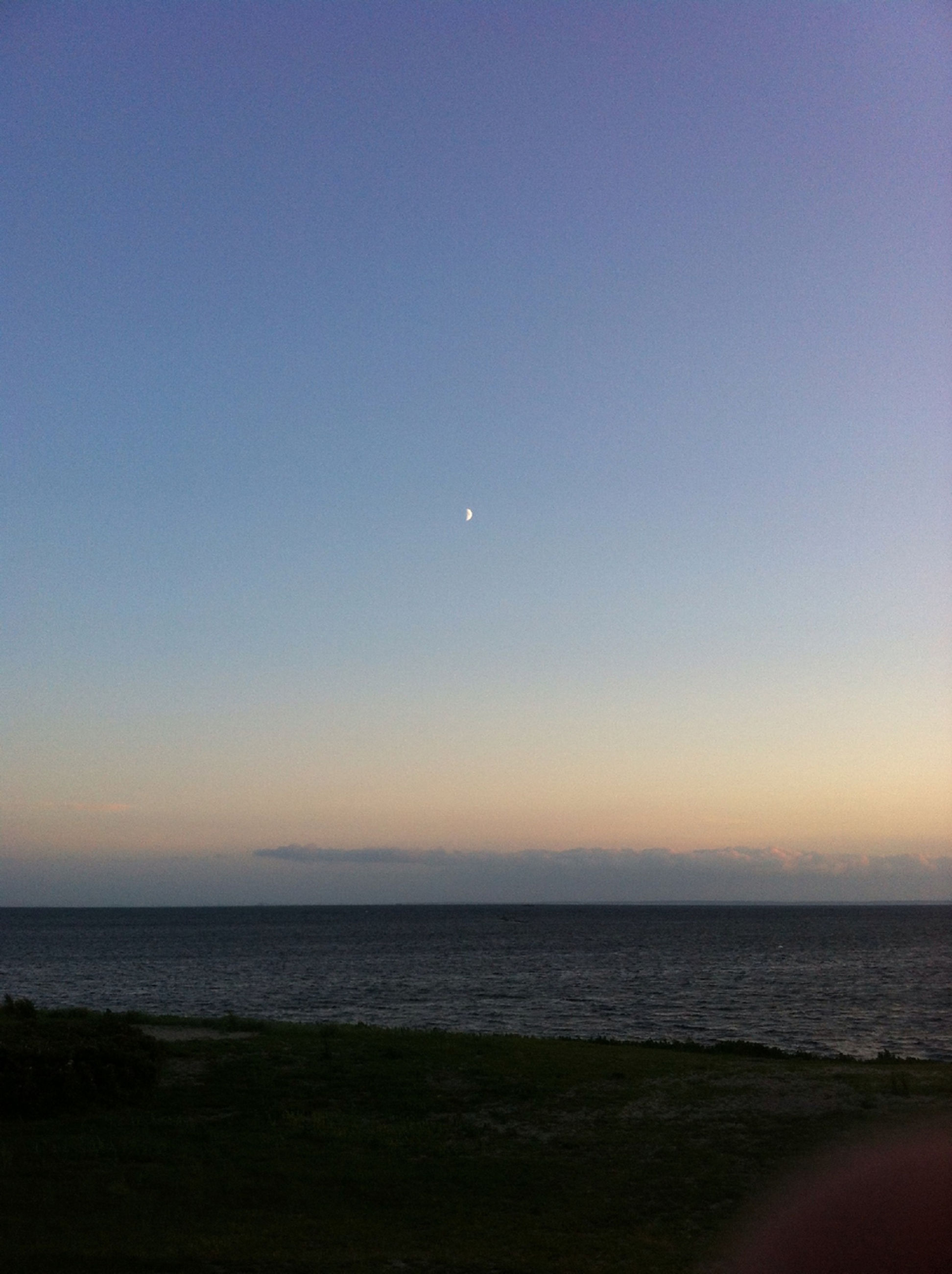 sea, horizon over water, clear sky, copy space, water, scenics, tranquil scene, beach, tranquility, beauty in nature, nature, shore, idyllic, blue, sunset, remote, outdoors, sky, coastline, dusk