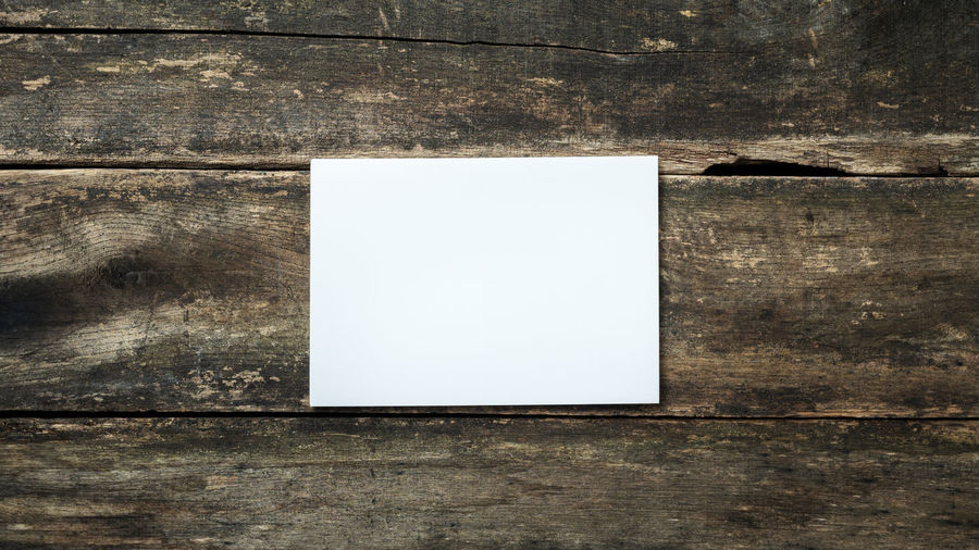High angle view of paper on table against wall