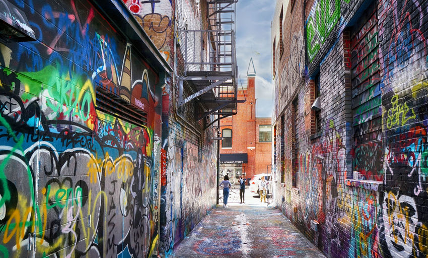 Architecture Building Exterior Graffiti City Built Structure Creativity The Way Forward Multi Colored Street Alley Real People Incidental People Diminishing Perspective Baltimore Maryland