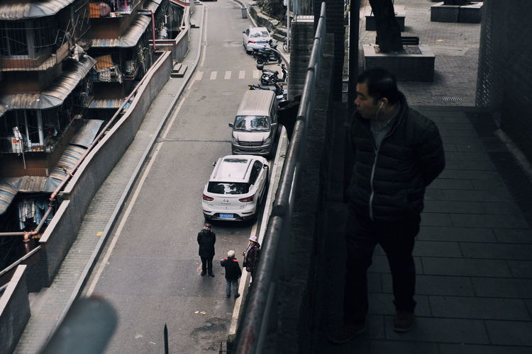 High angle view of man on street in city