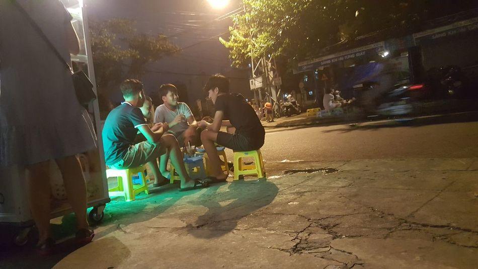 Friends chatting at streetfood stand in Da Nang, Vietnam. Đà Nẵng Vietnam Night Life Streetfood Friends