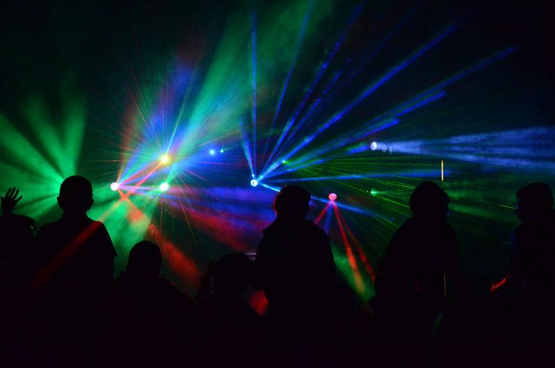 Silhouette people enjoying at nightclub
