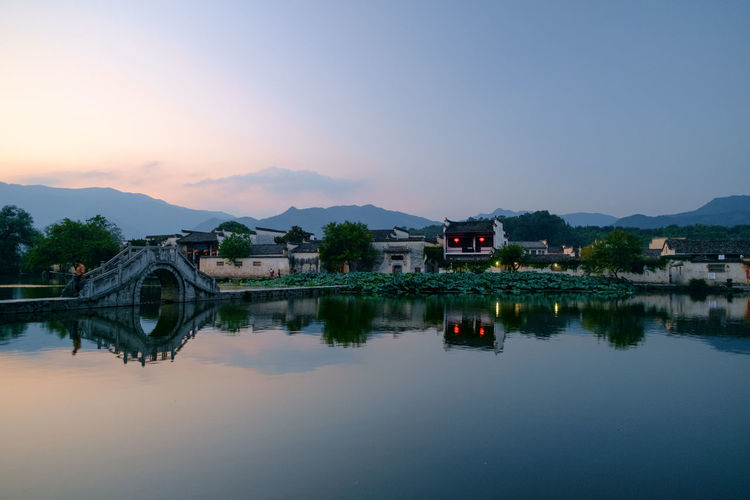 Hong cun Ancient Anhui,China Arch Bridge Architecture Beauty In Nature Bridge Bridge - Man Made Structure Building Building Exterior Built Structure China Dusk Mountain Nature No People Reflection River Sky Sunset Transportation Travel Destinations Water Waterfront EyeEmNewHere