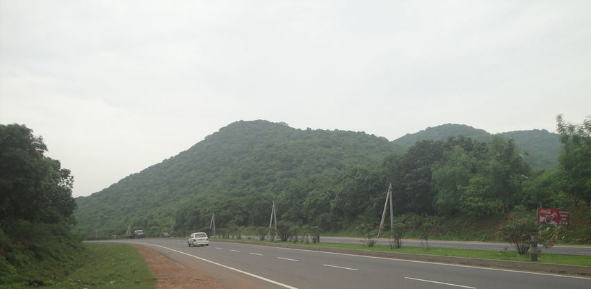 High Way Beauty In Nature Car Clear Sky Day Hills, Mountains, Sky, Clouds, Sun, River, Limpid, Blue, Earth Mountain Nature No People Outdoors Road Scenics Sky The Way Forward Transportation Tree
