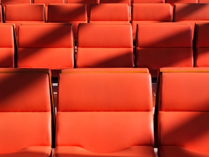 Full Frame Shot Of Empty Red Chairs In Movie Theater