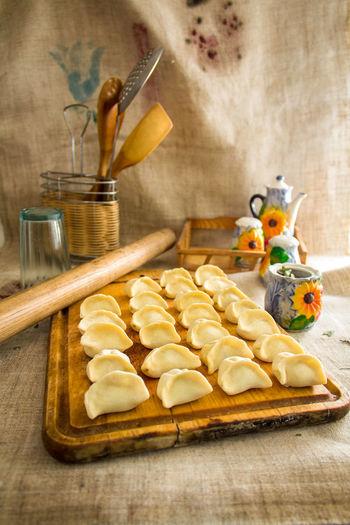 Close-up of dumplings on wooden serving board