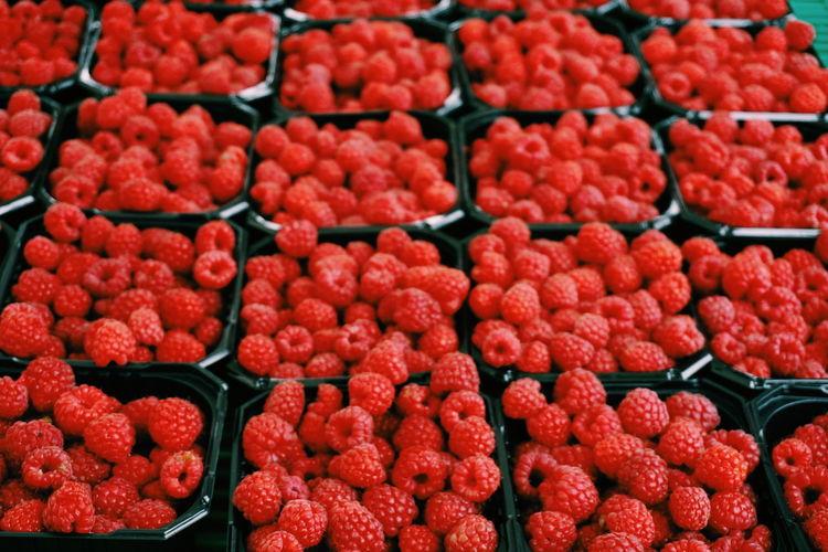 Full frame shot of raspberries for sale at market