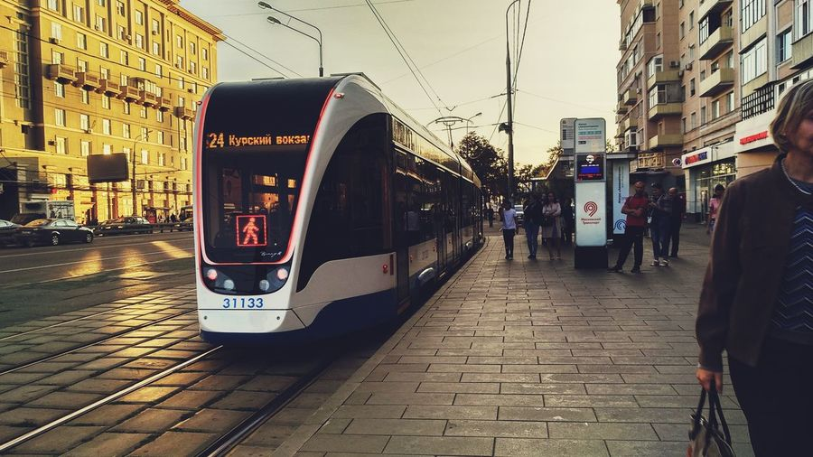 View of train on street in city