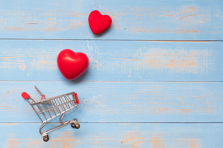 red heart shape on blue background Blue Blue Background Consumerism Copy Space Creativity Directly Above Emotion Food Food And Drink Fruit Heart Shape High Angle View Indoors  Love No People Positive Emotion Red Shopping Cart Still Life Studio Shot Table Wood - Material
