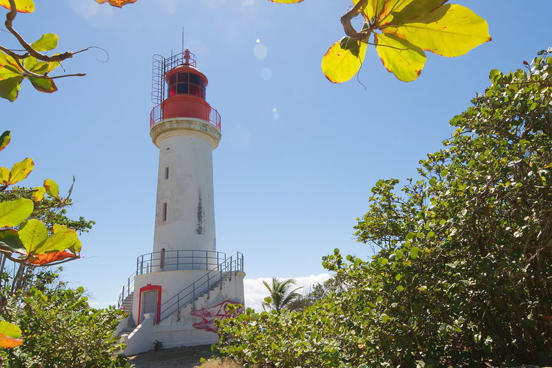 Lighthouse on the Gosier Island - Guadeloupe Caribbean island Antilles Architecture Art Building Caribbean Day Gosier Graffiti Guadalupe Guadeloupe Guidance Island Le Gosier Lighthouse Low Angle View No People Outdoors Paradise Red Safety Sky Structure Tropic Tropical White