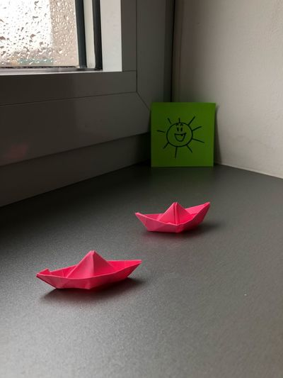 Close-up of paper boats on table at home