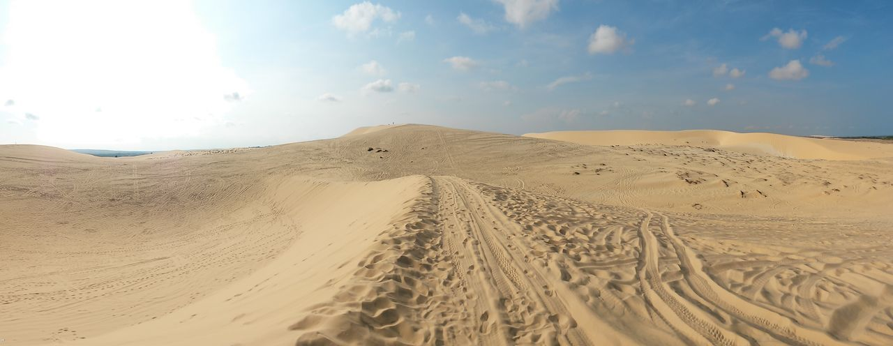 Mui Ne, Vietnam South East Asia Vietnam Arid Climate Beauty In Nature Climate Desert Desert Landscape Environment Land Landscape Nature No People Non-urban Scene Outdoors Pattern Remote Sand Sand Dune Scenics - Nature Sky Tire Track Tranquil Scene Tranquility