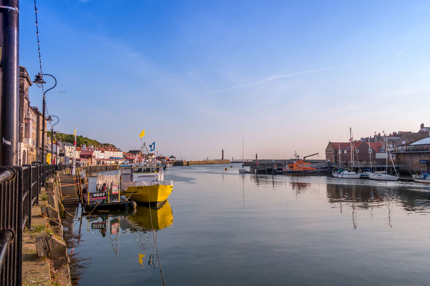 Whitby Whitby Harbour Whitby View Whitby North Yorkshire North Yorkshire North Yorkshire Coast Marina Boat Boats Ship Port Seaside Town Seaside Tourist Destination Sea Blue Sky Water Sky Passenger Craft Cloud - Sky Sailboat River Outdoors No People Harbor