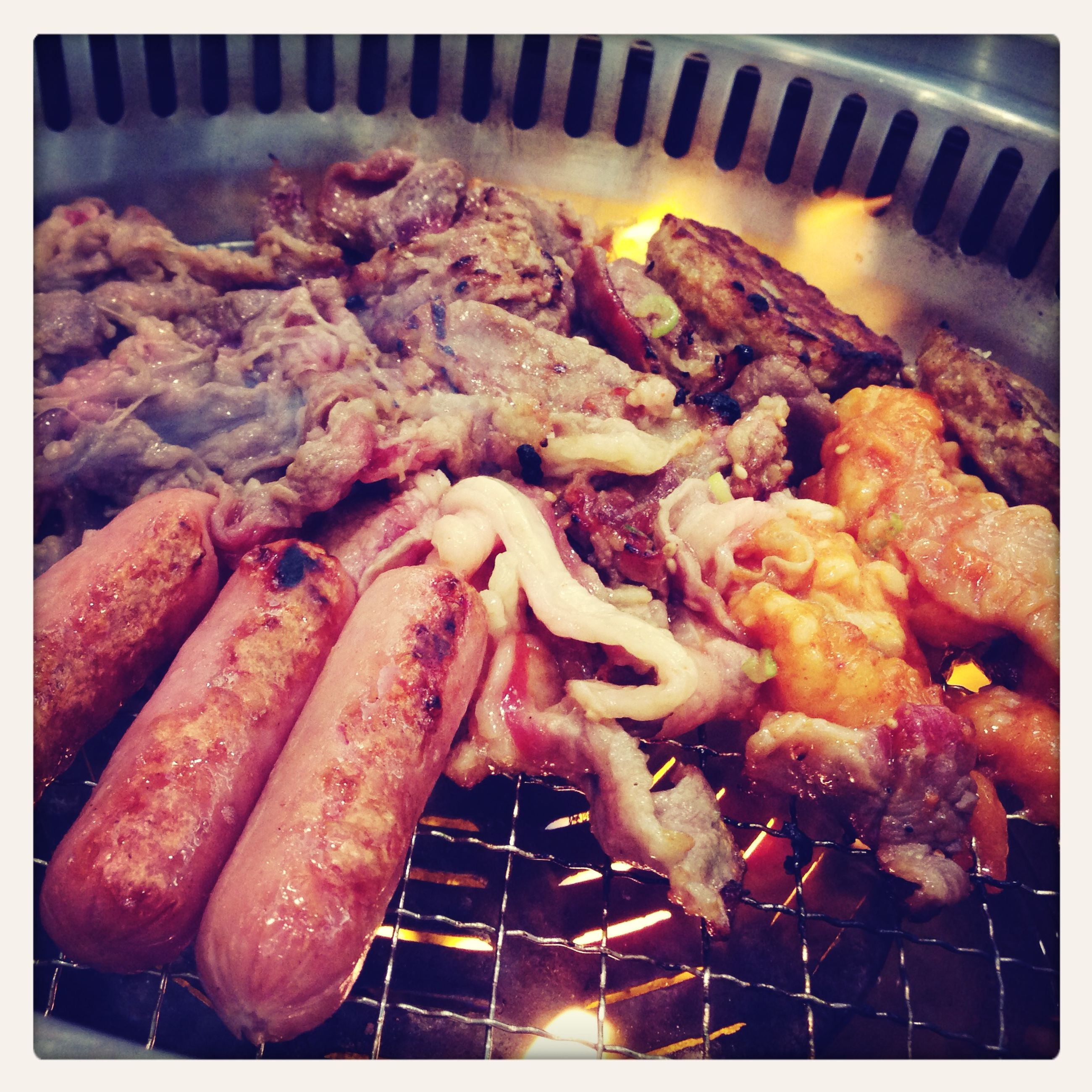 food and drink, food, transfer print, indoors, freshness, meat, grilled, auto post production filter, close-up, barbecue grill, barbecue, high angle view, preparation, still life, cooking, healthy eating, seafood, heat - temperature, roasted, ready-to-eat