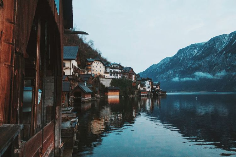 Architecture Boat Building Exterior Built Structure Community Hallstatt Horizontal Symmetry House Human Settlement Lake Leading Moored Narrow Nautical Vessel Outdoors Reflection Residential District Residential Structure River Roof Water Waterfront