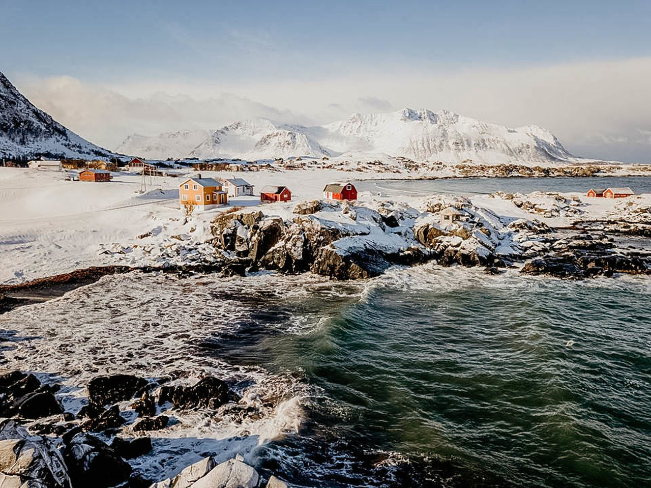water, winter, mountain, scenics - nature, cold temperature, beauty in nature, snow, sky, nature, day, group of people, real people, sea, rock, motion, mountain range, land, snowcapped mountain, outdoors
