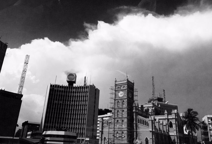 Learn & Shoot: Balancing Elements Appreciate Architecture. The clouds over this structure is amazing.😍 Building in Victoria island Lagos city : an historic building. Catholic Church, Uac building. Masts #photography #iphoneography #historicbuilding #lagos #victoriaisland #church #nigeria #skyscrapers #blackandwhite Lines And Shapes IPhoneography Landscape Buildings Old Buildings Monochrome Blackandwhite Structures Nigeria Lagos Nigeria Clouds And Sky