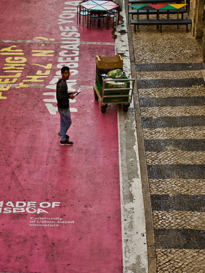 Full Length One Person Men Real People Architecture High Angle View Casual Clothing Standing Walking Lifestyles Day Footpath Built Structure Outdoors City Staircase Side View Communication