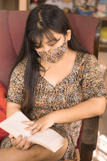 Midsection of woman holding book