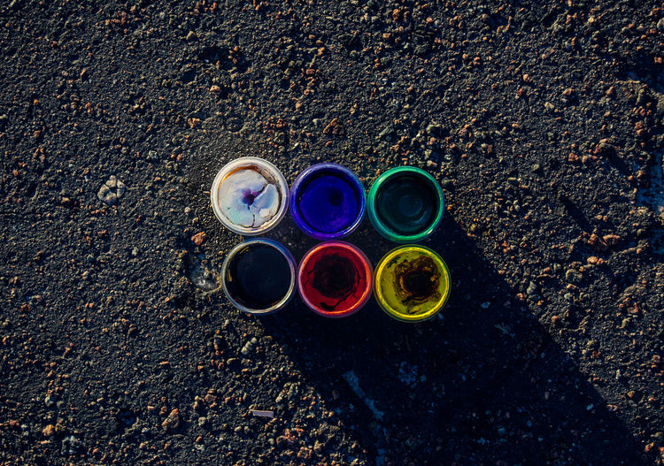 Directly above shot of color bottles on road