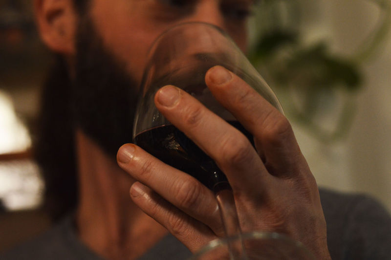 Close-up of man drinking wine