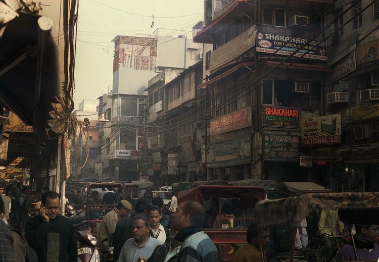 Old Delhi. 35mm Portra400, Leica M3 Imagine the energy of Times Square with the rustic dust and grit of 19th century China. Old Delhi is magical and surreal. Building Exterior Built Structure Large Group Of People Real People Men Women Architecture Lifestyles Outdoors City Day Adults Only Adult People Film Photography Filmisnotdead