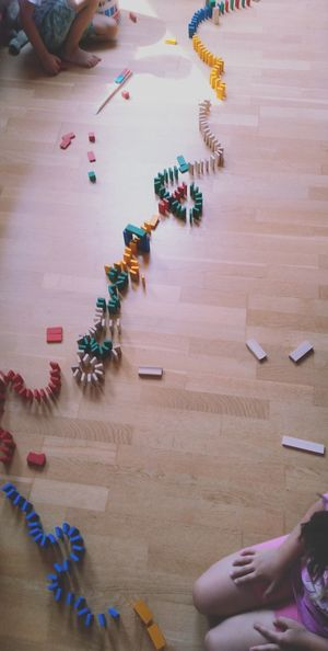 Midsection of girl playing with toys on hardwood floor