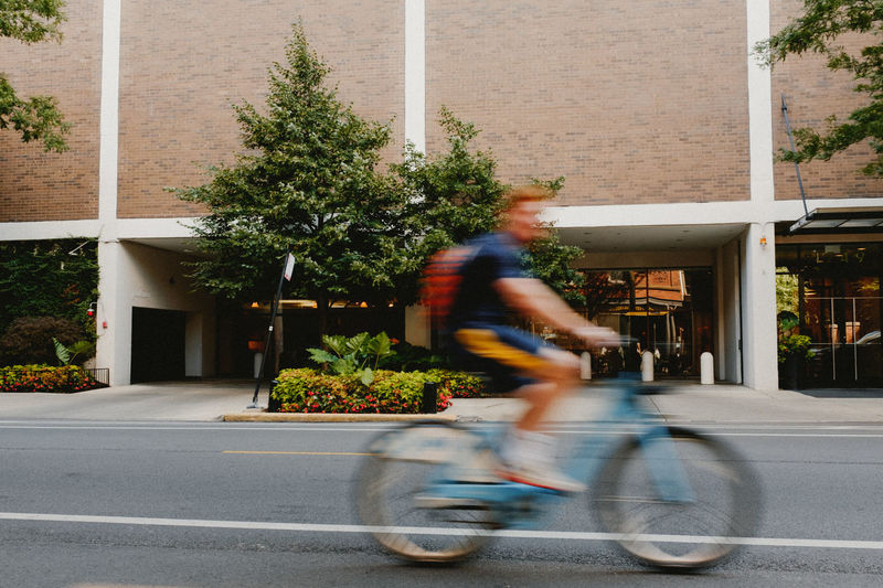 Adult Adults Only Architecture Bicycle Building Exterior Chicago City Cycling Day Motion One Man Only One Person Only Men Outdoors People Slow Shutter Transportation Tree Young Adult