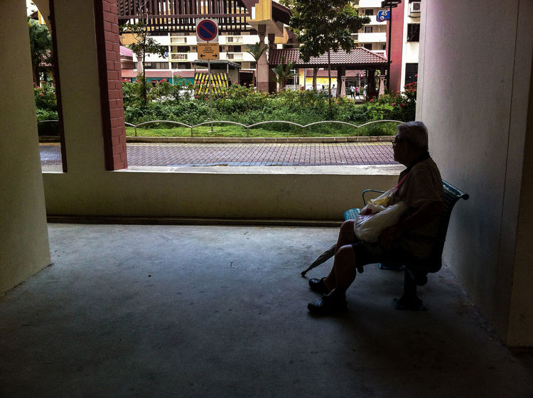Lonely Old Man Sitting Alone Void Deck Housing Estate One Person Adult Residential Area Street Photography Streetphotography Streetphoto_color Street Life Everybodystreet IPhone Photography