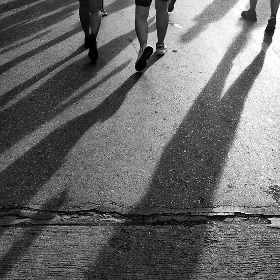 Low section of people walking on road