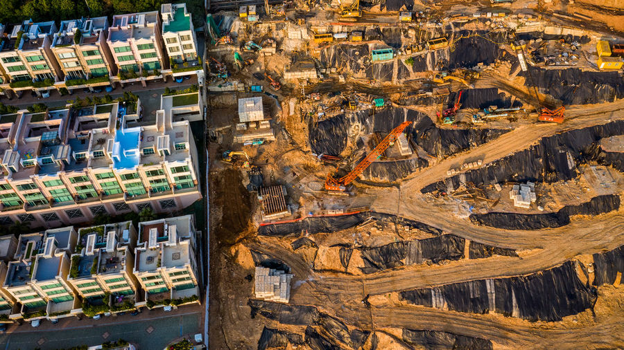 Aerial view of buildings by construction site