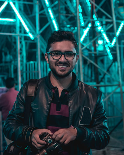 Adult Beard Eyeglasses  Front View Happiness Illuminated Indoors  Looking At Camera Night One Person People Portrait Real People Smiling Standing Young Adult This Is Masculinity HUAWEI Photo Award: After Dark
