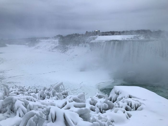 Scenic View Of Niagara Falls Against Cloudy Sky During Winter