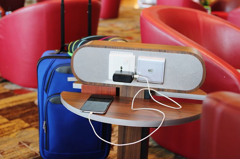 High angle view of mobile phone charging on table