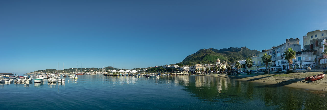 Port of Forio. Ischia Architecture Beach Blue Cityscape Day Harbor Ischia Island Isle Landscape Landscape_Collection Moored Mountain Nature Nautical Vessel No People Outdoors Panoramic Photography Portrait Reflection Scenics Sea Seaside Vacations Village Water