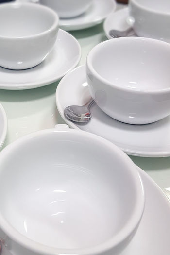 Beverage Refreshment Ceramics Clean Close-up Conference - Event Conference Room Crockery Cup Empty High Angle View Hospitality Large Group Of Objects No People Saucer Table Tea Cup White Color British Culture