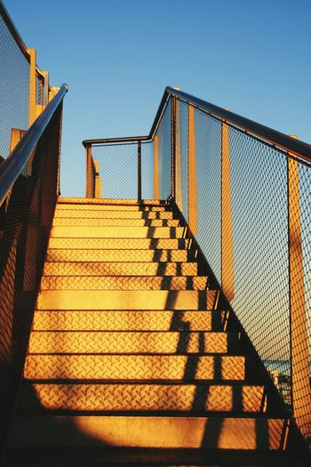 Steps Low Angle View Steps And Staircases Architecture Clear Sky Railing Building Exterior Outdoors Built Structure The Way Forward No People Blue Staircase Bannister Day