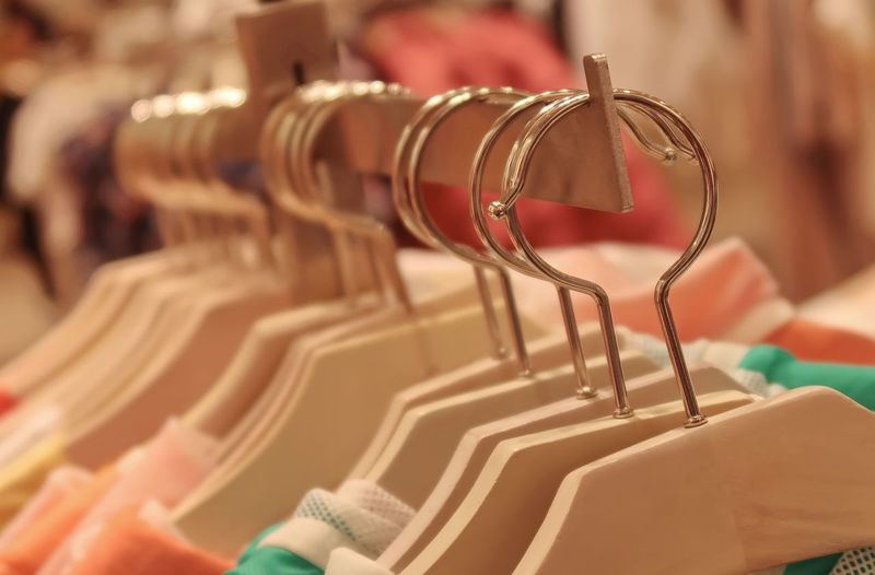 Clothes hangers in a shop Shopping Hanging Collection For Sale Fashion Store Order Arrangement Clothing Detail Indoors  Business Retail  Close-up Rack Trendy Wear No People Coathanger Clothing Store In A Row Selective Focus Clothes Rack Retail Display Indoors  Large Group Of Objects Focus On Foreground Retail  Repetition
