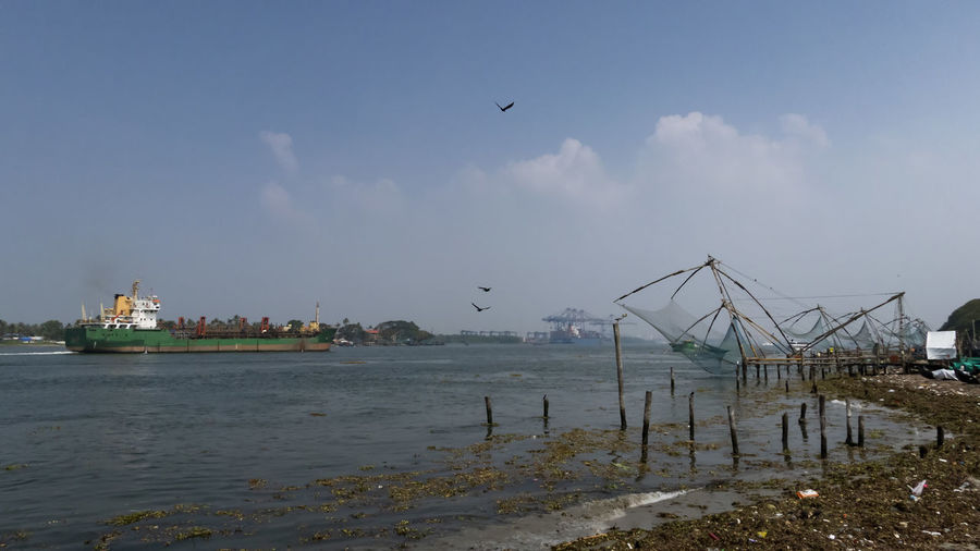 Chinese fishing nets. Fort Cochin, Kerala, India Water Sky Sea Nautical Vessel Transportation Animal Mode Of Transportation Animal Themes Nature Day Outdoors Bird Flying Fishing Industry Chinese Fishing Nets Fort Cochi Kerala, India Keralatourism