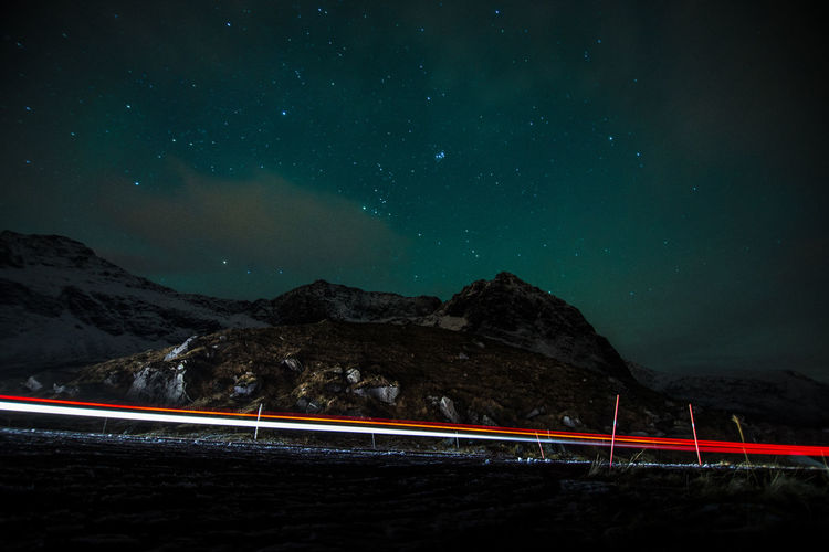 Rush through! Astronomy Beauty In Nature Galaxy Illuminated Light Trail Long Exposure Motion Mountain Nature Night Night Lights Nightphotography No People Northern Lights Norway Norway🇳🇴 Outdoors Road Scenics Sky Speed Star - Space Star Trail Transportation EyeEm Selects HUAWEI Photo Award: After Dark Humanity Meets Technology Analogue Sound