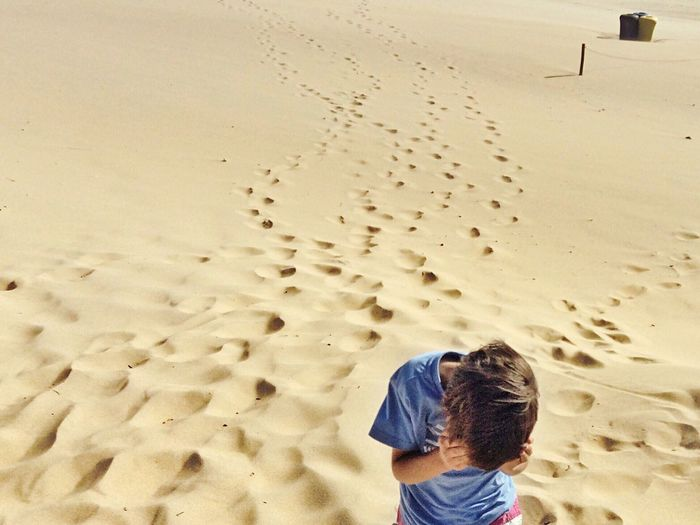 Boy Standing On Beach At Praia Do Guincho