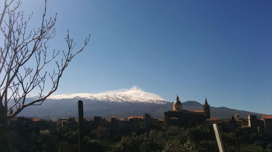 C'è un senso di sacro nelle montagne sicule Bare Tree Beauty In Nature Blue Chuches Clear Sky Etna Mountains Overview Travel Destinations
