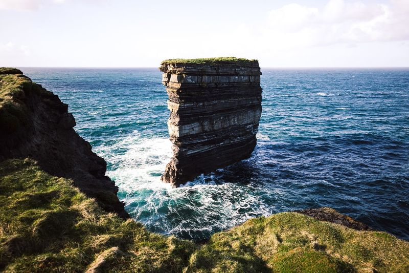 Ireland formations. Ireland Water Sea Horizon Sky Nature Horizon Over Water Beauty In Nature Scenics - Nature Tranquility Sunlight Beach Day Tranquil Scene Rock Land No People Outdoors Solid Rock - Object