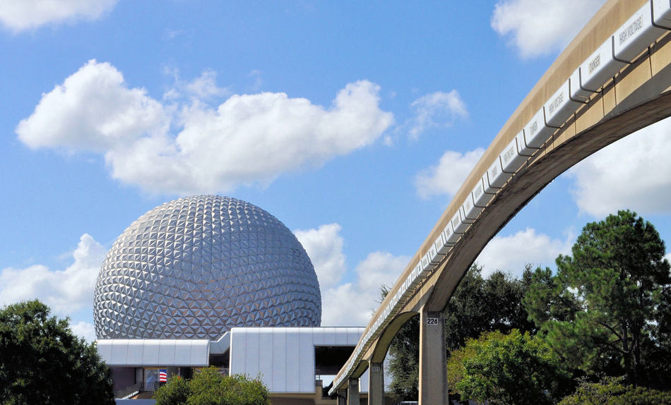 What better way to get to Epcot than the monorail DisneyWorld Geodesic Dome Orlando, Florida- Disney Architecture Arriving Building Exterior Built Structure Cloud - Sky Day Dome Epcot Modern Monorail  Nature No People Outdoors Sky Tracks Travel Destination Travel Destinations Tree Vacation Wide Shot