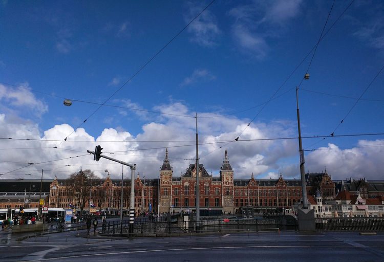 View of amusement park against cloudy sky