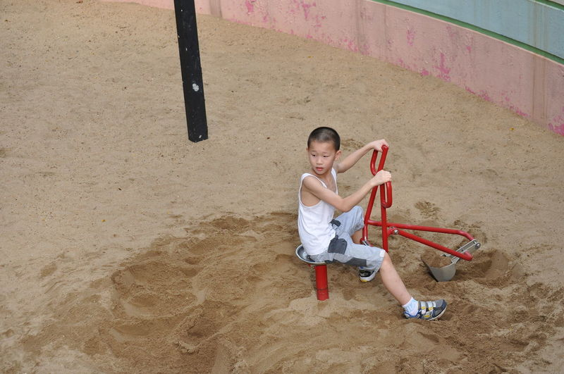 the trip of Hong kong park Full Length Child Childhood One Person High Angle View Offspring Playing Males  Men Boys Day Sport Holding Lifestyles Leisure Activity Outdoors Standing Casual Clothing Arms Raised Human Limb