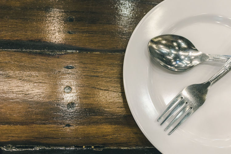 Alloy Close-up Directly Above Eating Utensil Food Food And Drink Fork Glass High Angle View Household Equipment Indoors  Kitchen Utensil Knife Metal No People Plate Setting Silver Colored Spoon Steel Still Life Table Table Knife Temptation Wood - Material