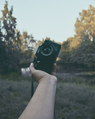 Human Hand Photography Themes Camera - Photographic Equipment Photographing Photographer Old-fashioned Men Holding Retro Styled Tree